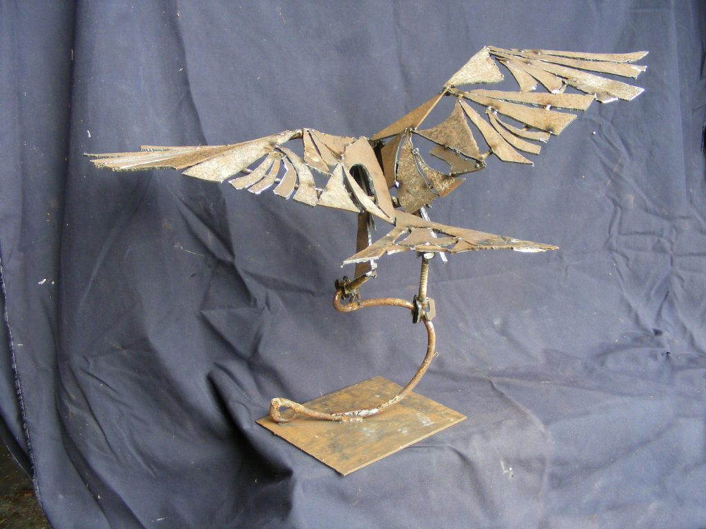 Raptor On Bucket Handle Small Sculpture Greta Berlin